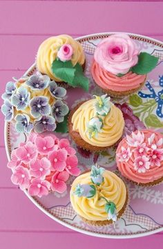 Spring cupcakes with bright frosting and beautiful sugar flowers