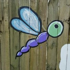 Painted by Jenny Bates in Tallahassee, FL in 2017. Outdoor garden yard painted fence mural (detail).