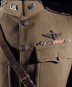 "November 6, 1930: Captain Edward ""Eddie"" Rickenbacker was awarded the Medal of Honor for boldly attacking seven enemy airplanes alone and shooting down two of them on September 25, 1918. He was the United States' top scoring ace during World War I, with 26 confirmed aerial victories. Pictured here is his service coat. See it on display at our Udvar-Hazy Center in VA."