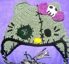 Zombie Hello Kitty Hat <3 it!!  this is another etsy thing. i plan on studying the hell out of this picture and making it for my ma for xmas! because really, 25 bux is entirely too much for a hat that i can make myself.