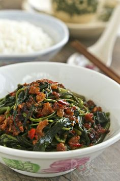 Kangkung Belacan, a spicy stir fry dish of water spinach flavored with chilies and shrimp paste.
