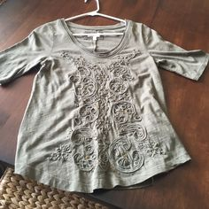 Anthropologie tee Beautiful olive green tee by Meadow Rue for Anthropologie.  Lovely design interspersed with gold sequins.  Center seam down back for added detail.  Scoop neck with raw edges.  100% cotton.  Gently used condition.  Third pic most accurately depicts color. Anthropologie Tops