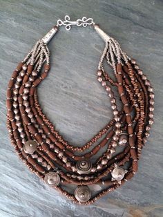 by Anna Holland | Necklace; 9 strands of some very different types of copper and silver beads, all from Africa, with six antique telsum beads from Ethiopia | 395$