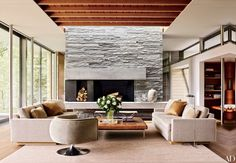 An Aspen, Colorado, home designed by Shelton, Mindel & Assoc. features midcentury furniture including the Joseph Paul D'Urso chairs by Knoll | archdigest.com
