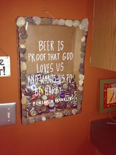 beer cap shadow box I made. I had a crate, used poster frame for the back and the plastic for the front. Glued plastic to front along with pebbles I collected from Lake Huron this summer. Wrote on front with chalk pen.