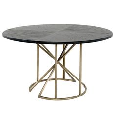 "Gabby's Bennie dining table presents a pop of swoon-worthy modernism to chic dwellings. This furnishing features an angular, sculptural metal base in lustrous brass. The round veneer top boasts a black cerused finish, the wood grain details coming through with intriguing appeal. 54""W x 54""D x 30.25""H. Wood, metal. Cerused black oak, stainless gold finishes. Due to the handmade artistry of Gabby's collection, variation between individual products should be expected."