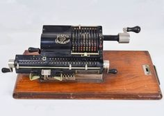 An antique pinwheel calculator by Rapid Calculator Company, USA. This antique calculator features a heavy, black metal body with four rotating cranks for multiplication and division problems. Decoration Piece, Beautiful Decoration, Multiplication And Division, Typewriters, Cool Tools, Pinwheels, Calculator, Black Metal, Industrial