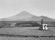 The volcano Sumbing seen from the Resident's house at Magelang, with a Buddha sculpture in the garden. Date April 1935.
