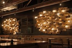 Umami Burger, Anaheim California. This custom lighting installation was created from hundreds of circa-1929 license plates that were found buried on the job site, a once Packard dealership.