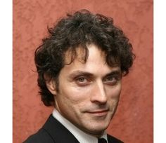 Rufus Sewell, reminds me more of what an evil Sherlock would look like, though not Moriarty.