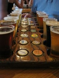 Beer Flight Bottle Cap Idea- they do this at Russian River Brewery (aka home of Pliney)