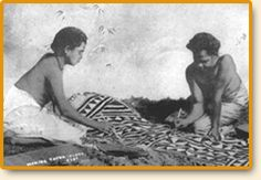 "This early photograph shows two women making ""masi,"" or tapa cloth. The masi in the photo is almost completed, as the women are stenciling final designs onto the large cloth (a technique called ""kesakesa."") Masi is made from bark, and was originally used for clothing and ceremonial purposes. Today, masi clothing is only worn for special occasions, and most masi is used for decorative purposes."