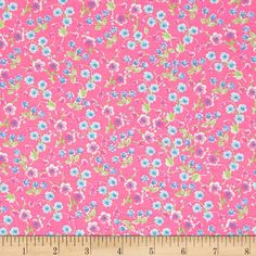 This cotton print fabric is perfect for quilting, apparel and home décor accents. Colors include white, pink, blue and green.