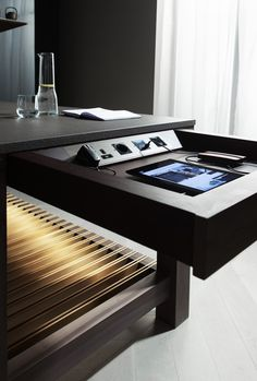 A special technology drawer hosting power points where all mobiles and gadgets can be plugged in to display recipes on the television screen. #TheFourthWall #Poggenpohl #technology