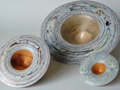 Kylie Cole; turned wood and layered magazine vessels and bowls.