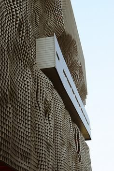 This is Raymund Abraham's new building in Beijing. Its 12 stories of aluminum eggcrate facade. photo by ben lepley