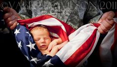 Military Baby Wrapped in The Flag...Dad Holding His Baby Wrapped in the Red, White & Blue