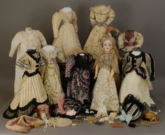Antique doll with beautiful wardrobe and accessories