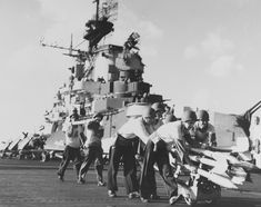 Crewmen of USS Hancock preparing rockets for an aircraft strike against Japanese positions on Formosa (Taiwan) 12 Oct (US National Archives) Uss Hancock, Essex Class, Subic Bay, Go Navy, Leyte, North Vietnam, Flight Deck, Aircraft Carrier, Vietnam Travel