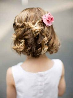 Your flower girl probably has her own opinion and style. This fun half-up hairstyle lets her have the best of both worlds with curls and accessories.