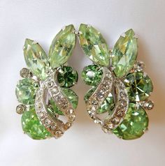 These gorgeous signed Eisenberg rhinestone earrings are minty summer green large, prong set marquis and round stones accented by clear smaller