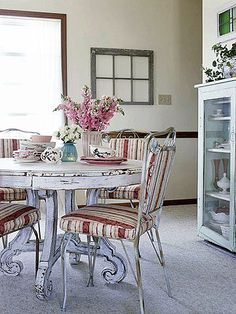 Call it the dining set that almost wasn't. The homeowner scored the metal chairs for free after someone rescued them from a landfill. They sat unused until the distressed harp-style table entered the scene. Finally, the perfect match, albeit in a perfectly unmatched way.
