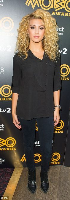 Simple style:Tori Kelly went for an all-black look including biker boots and a shirt...