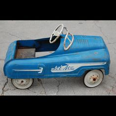 My blue pedal car