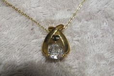Buy Gold plated pendant Trianglar Cubic and Dark blue topaz with Gold plated chain 44cmfor R60.00