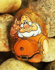 7 dwarf - I so liked the one I did for a friend that I did one for myself. Rock Painting Ideas Easy, Rock Painting Designs, Paint Designs, Pebble Painting, Pebble Art, Stone Painting, Stone Crafts, Rock Crafts, Coin D'art