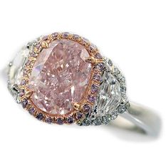 Oval-Shaped Fancy Yellow Diamond Ring: Accompanied by a GIA-Certified Fancy Pink Center Diamond, weighing 2.18 carats, natural color. Also accompanied by White & Pink Diamonds.
