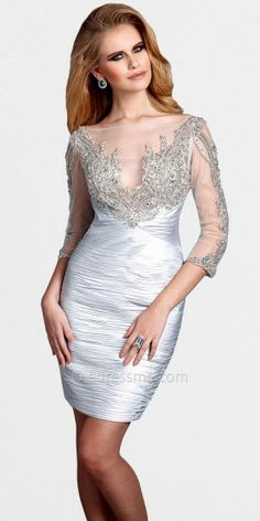 This showstopping dress features intricate jeweled detailing on both its three quarter sleeves and around its neckline. ...Price - $649.00 - uo4FKmQh