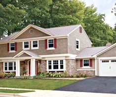 I love the look of this house - it is faux stone siding with complementary vinyl siding above.