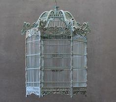 Victorian bird cage 2...Higgins has a bird in his study