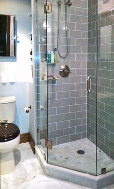 corner shower with built-in shelving behind