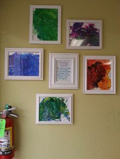 Framed artwork gallery wall, toddler classroom. White frames, art dsplay, classroom display, documentation, process art, evidence of learning, classroom decor, homey classroom design.