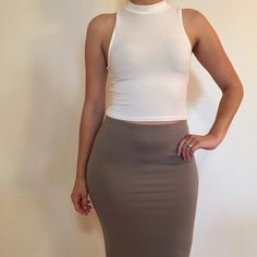 White Mock Neck Sleeveless Crop Top White Mock Neck Sleeveless Crop Top. Brand new. Never worn. Available in S-M-L. Model is wearing a small, for reference. No Paypal. No trades. 10% discount on all bundles made with the bundle feature. No offers will be considered unless you use the make me an offer feature.     Please follow  Instagram: BossyJoc3y  Blog: www.bossyjocey.com Tops Crop Tops