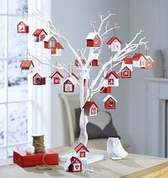 Display advent houses on White Twig Tree from Hobbycraft . Display advent houses on White Twig Tree from Hobbycraft More We are want to say thank. Advent Calendar House, Wooden Advent Calendar, Homemade Advent Calendars, Christmas Calendar, Chocolate Advent Calendar, White Twig Tree, White Twig Christmas Tree, Christmas Home, Christmas Holidays