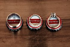 Wedding rings displayed on Jamaica Red Stripe beer bottle cap.  Just another way to personalize your pictures.