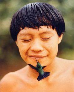 Brazil   Yanomami child with a bird.  Amazon    © Rosa Gauditorio/Hard Rain Picture Library