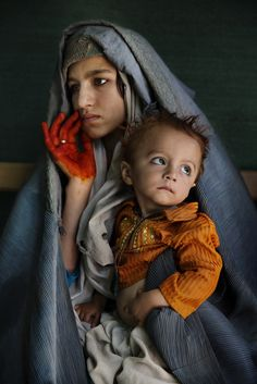 """A young mother and her son in Afghanistan, from the book """"Afghanistan: Between Hope and Fear"""" by Reportage photographer Paula Bronstein. Paula's book chronicles the last 15 years of Afghan history, with an emphasis on civilian victims of war, women's. Robert Doisneau, We Are The World, People Around The World, Afghan Girl, American Illustration, Reportage Photo, Mother And Child, Photojournalism, Photos"""