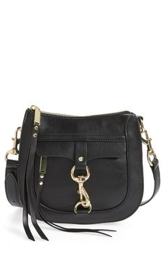 New favorite from Rebecca Minkoff! A clip-lock front fold brings a modern flourish to this chic leather bag in a classic saddle silhouette.