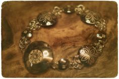 Handcarved silver bracelet with reindeer antler button. Jewellery made by Tytti Bräysy