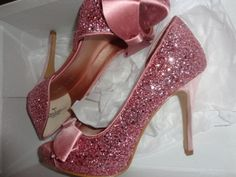 Sparkly pink heels with bows... I need just so they can sit on a shelf in my room where I can stare at them all the time. :D