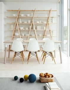 Kitchen storage made from wooden sawhorses that's been easily revised.