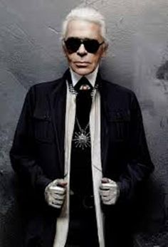 Karl Lagerfeld ~ Born Karl Otto Lagerfeld, 10 September 1933 (age 82) in Hamburg, Germany. German fashion designer, artist, and photographer based in Paris. He is the head designer and creative director of the fashion house Chanel as well as the Italian house Fendi and his own label fashion house. Over the decades, he has collaborated on a variety of fashion and art-related projects. He is well recognized around the world for his trademark white hair, black glasses, and high starched collars