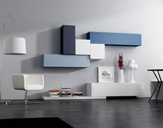 Aranżacje wnętrz - Salon: Meble modułowe - Średni salon, styl nowoczesny - Rosanero. Przeglądaj, dodawaj i zapisuj najlepsze zdjęcia, pomysły i inspiracje designerskie. W bazie mamy już prawie milion fotografii!