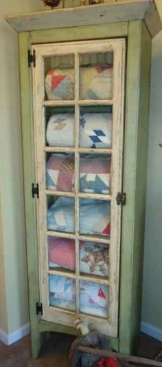 Rustic blanket cupboard with glass pane door