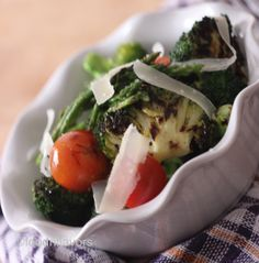 Slender spears of grilled asparagus, broccoli, cherry tomatoes curly twirls of Parmesan. A quick and healthy lunch idea. #spring | foodnflavors