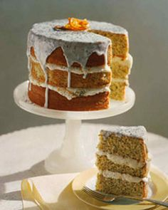 Citrus Poppy-Seed Cake | Martha Stewart Living - Poppy seeds and bright flecks of citrus zest accentuate the fine crumb of this tender triplex cake. Lemon glaze glides over the top.